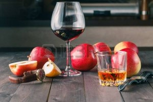 53524253-two-glass-of-alcohol-on-wooden-table
